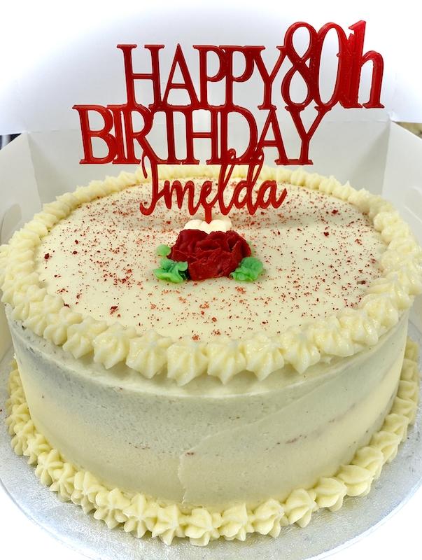 red velvet cake with decorative topper