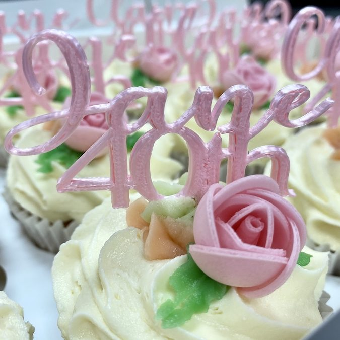 """Plastic topper on cupcake reads """"Jane 40th"""""""